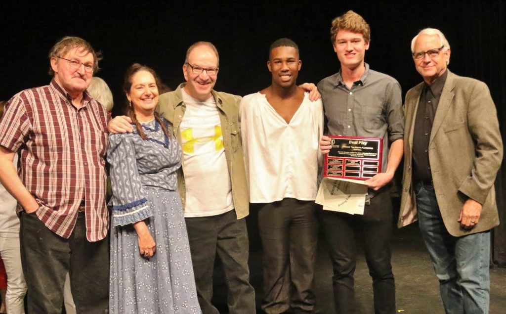 "The cast and director of ""Amazing Grace"" share the playwright's spotlight. Left to right: Chuck Conlon, Tami Vaughan, James Kassees, Letherio Jones, Luke Valadie, and director Preston Boyd. Photo by Richard DiSammartino."